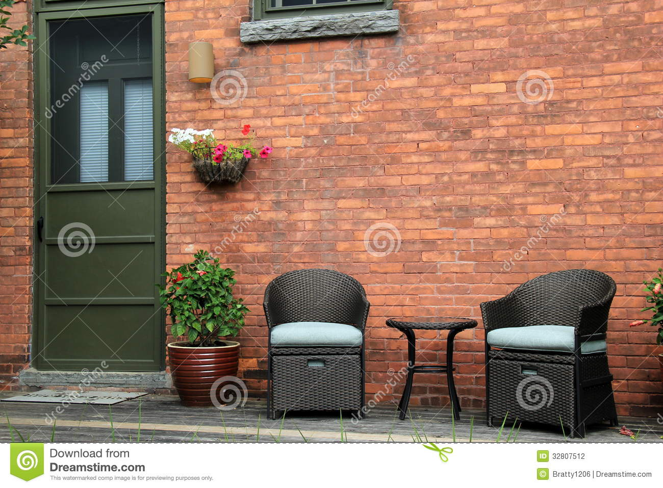 Download Attractive Wood Porch With Outdoor Furniture Of Old Brick Home.  Stock Photo - Image - Attractive Wood Porch With Outdoor Furniture Of Old Brick Home