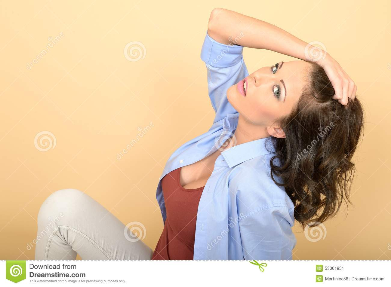 Attractive Young Beautiful Woman Sitting on the Floor