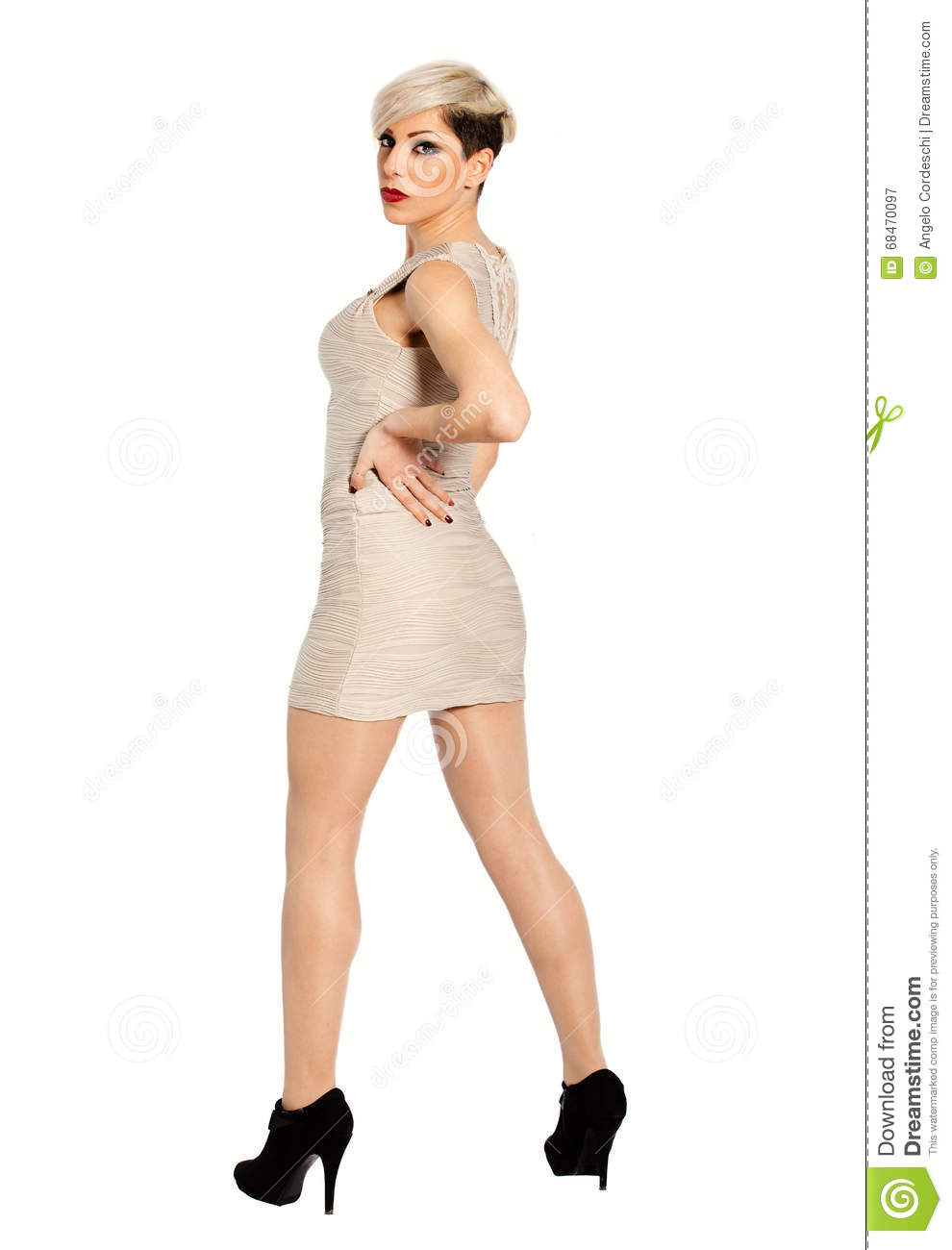 Attractive young blonde elegant woman on a white background. Full length