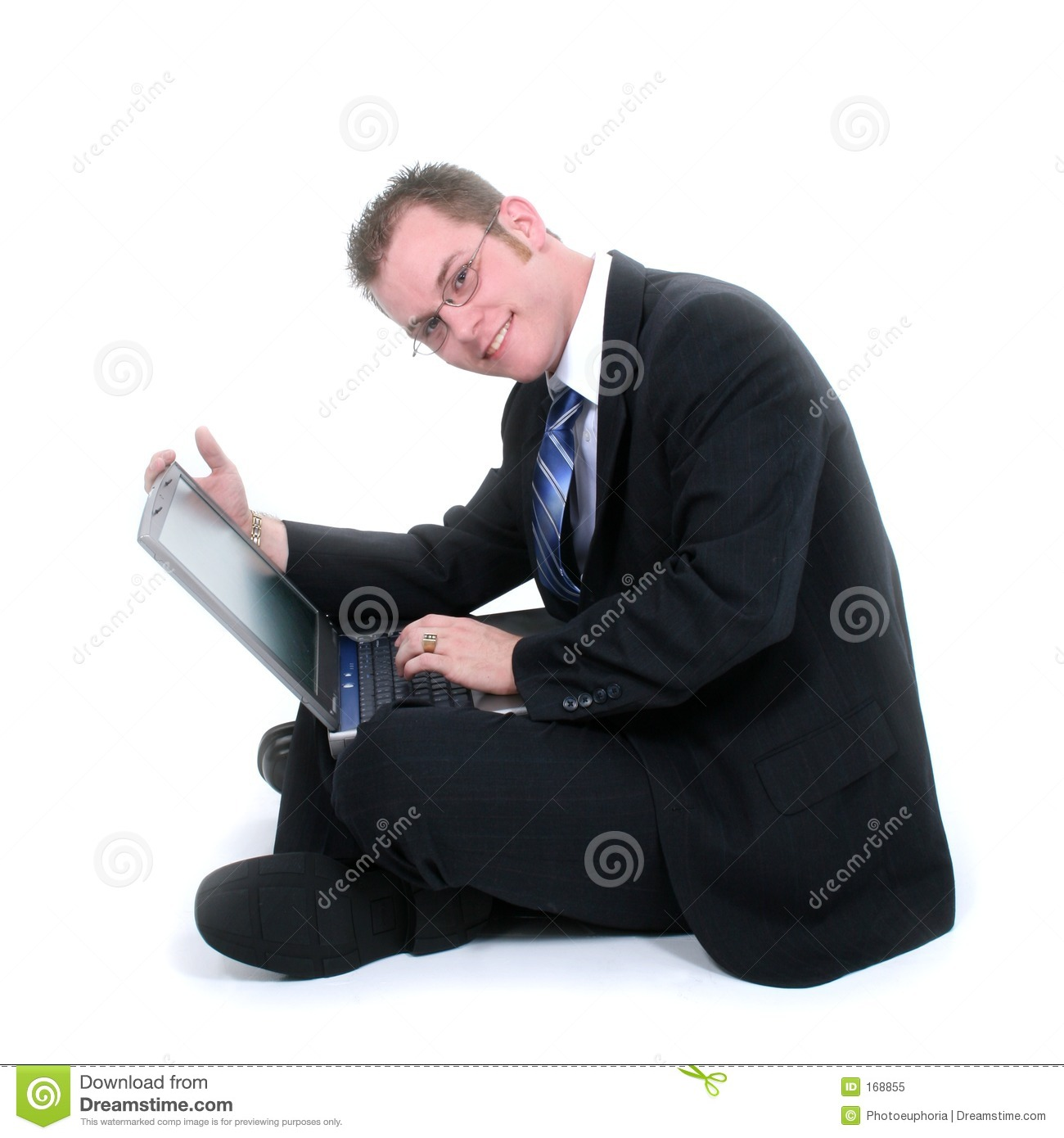 Attractive Young Businessman Sitting On Floor With Laptop