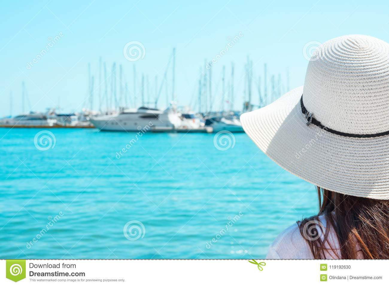 7c1cd5b05 Attractive Young Caucasian Woman With Long Hair In Hat Stands At ...