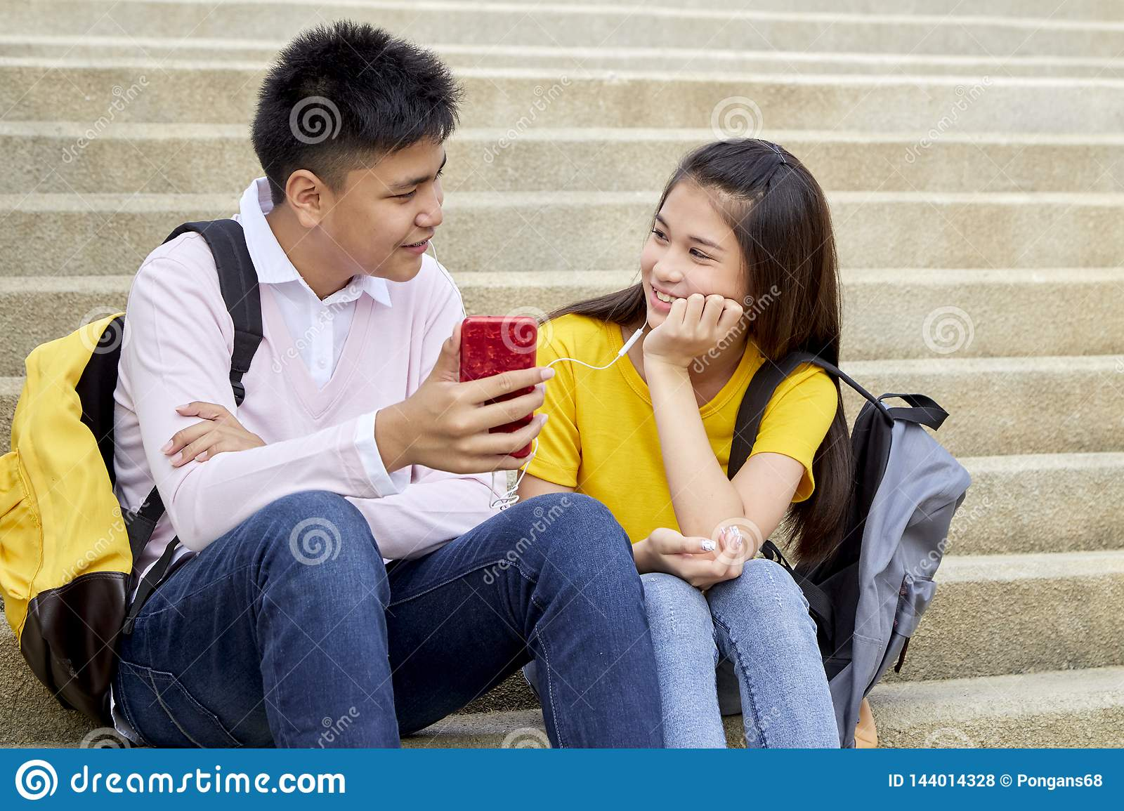 Attractive Young Couple Listening To Music Stock Photo Image Of