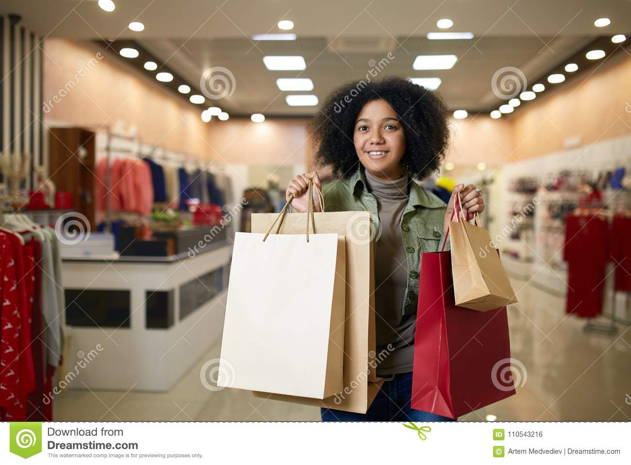 Download Attractive Young Cute African American Woman Posing With Shopping Bags With Clothing Store On Backgroud. Pretty Black Stock Photo - Image of american, people: 110543216