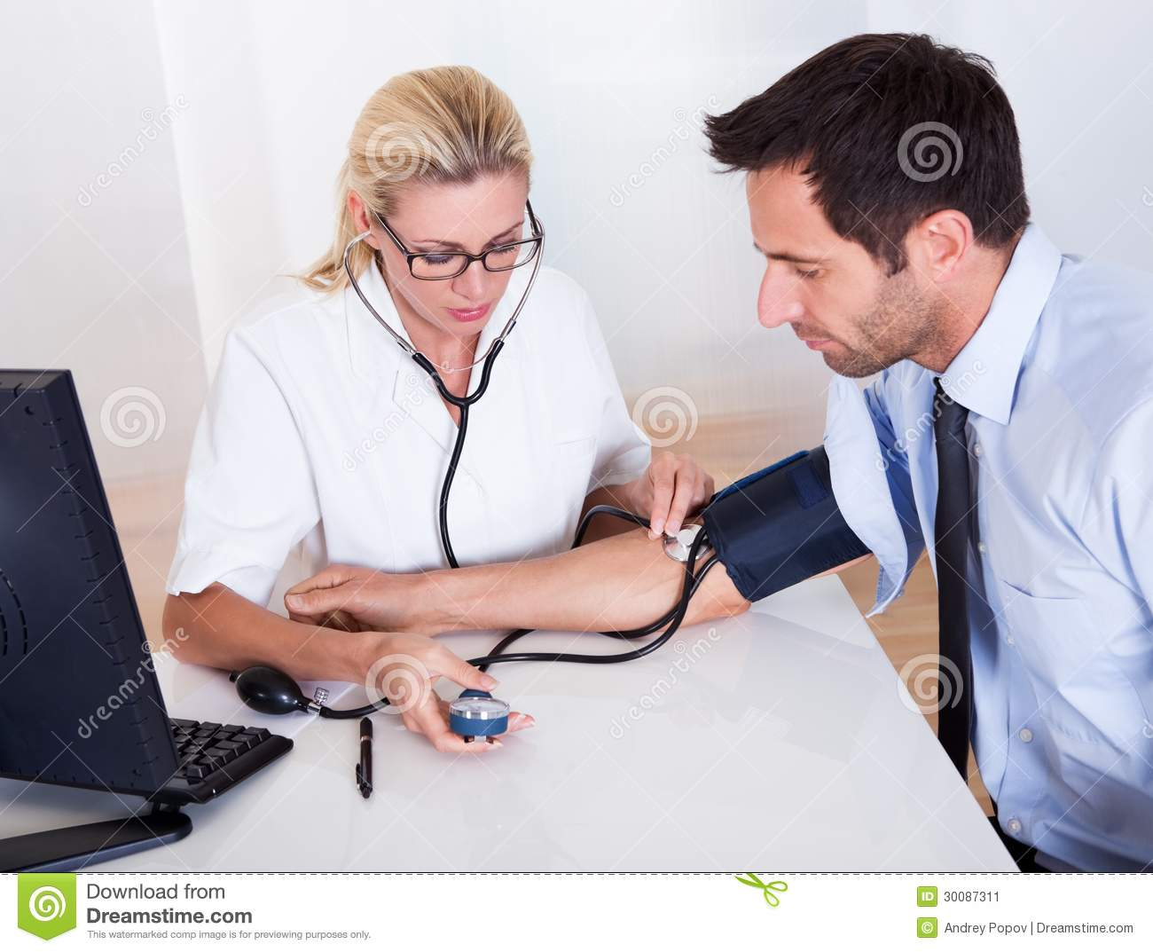 Doctor Taking A Patients Blood Pressure Stock Image ...