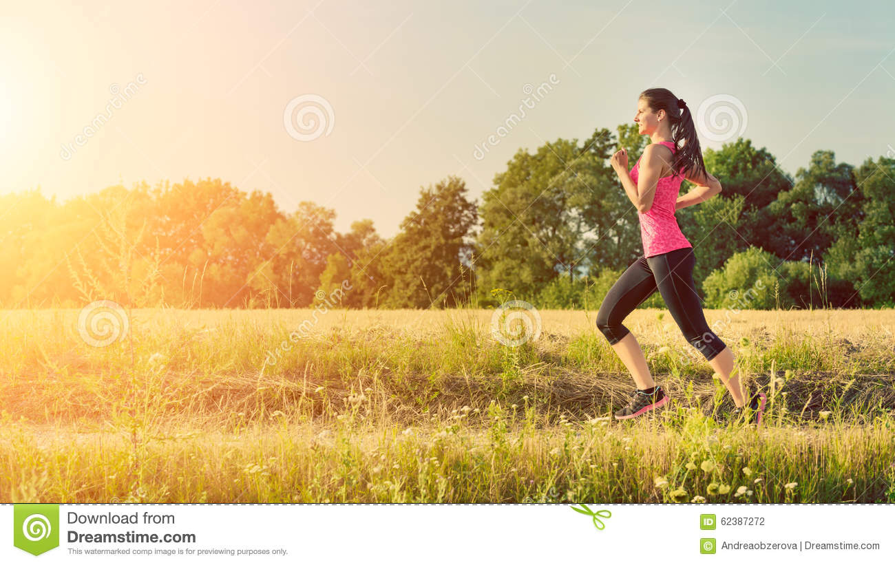 Attractive young female jogging