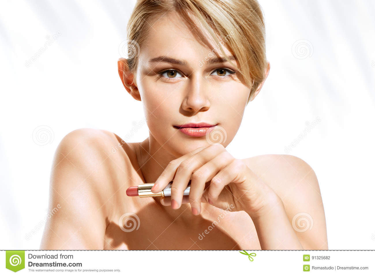 Attractive young girl with lipstick on white background