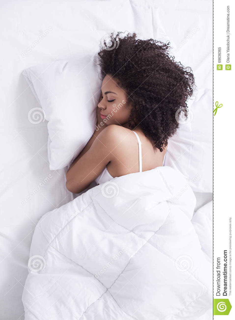 Attractive young girl is sleeping at home