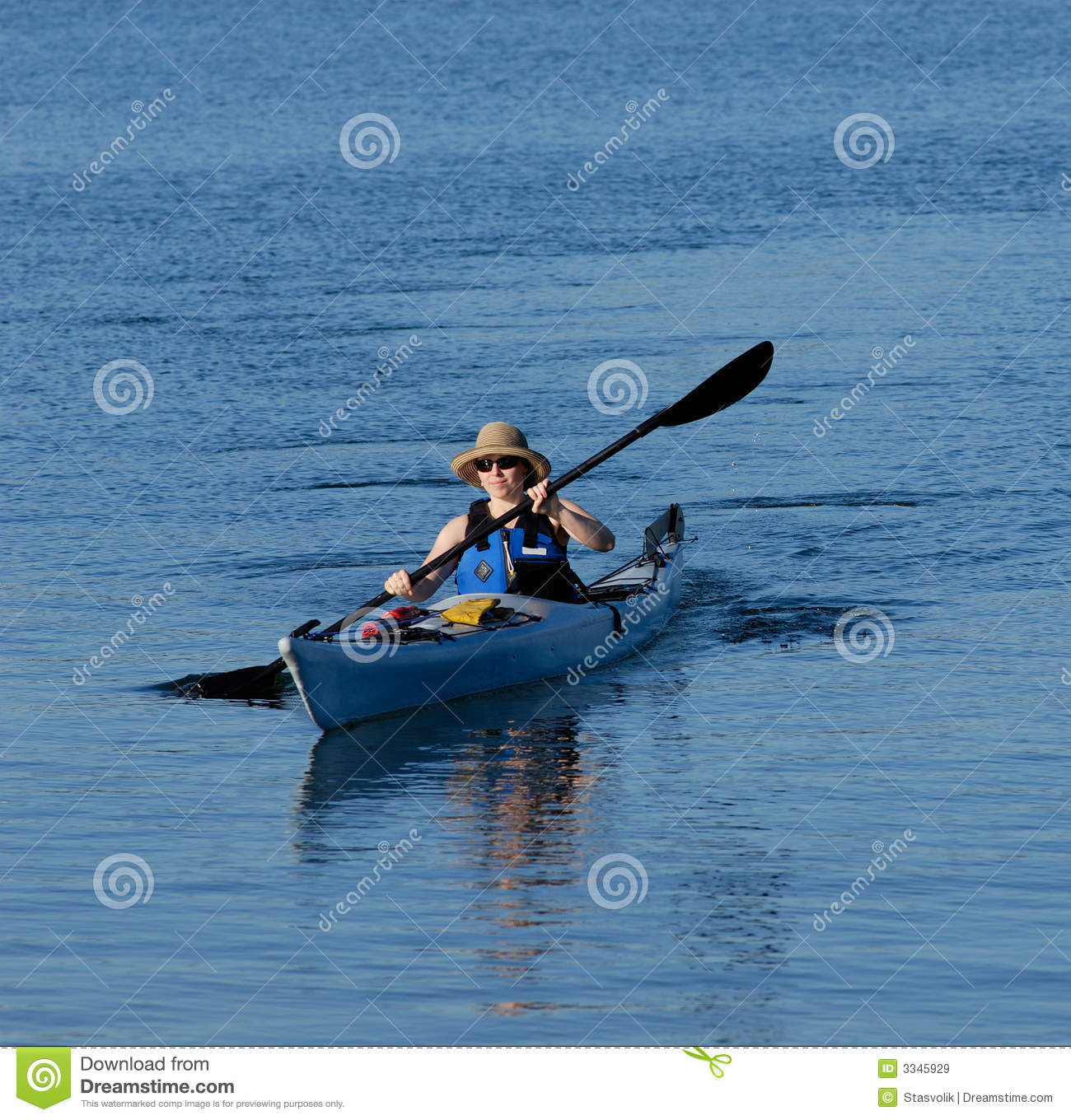 Attractive young lady kayaking