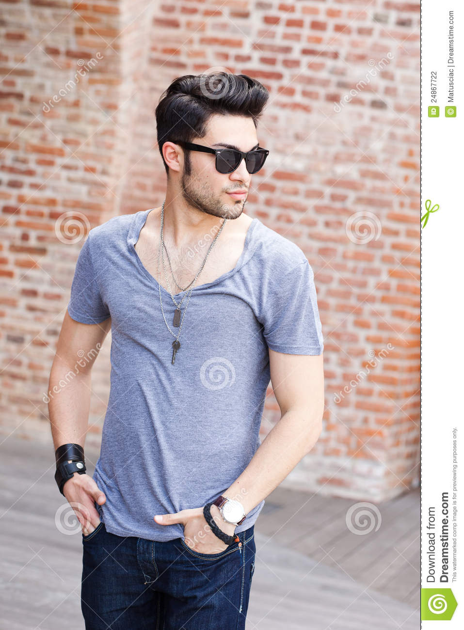 Attractive young male model posing outdoors