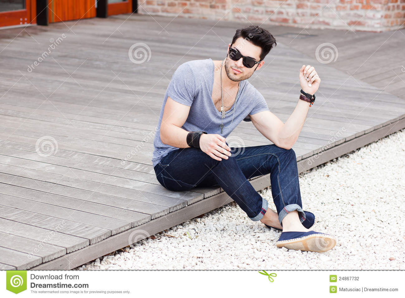 Attractive Young Male Model Posing Outdoors Stock Photo