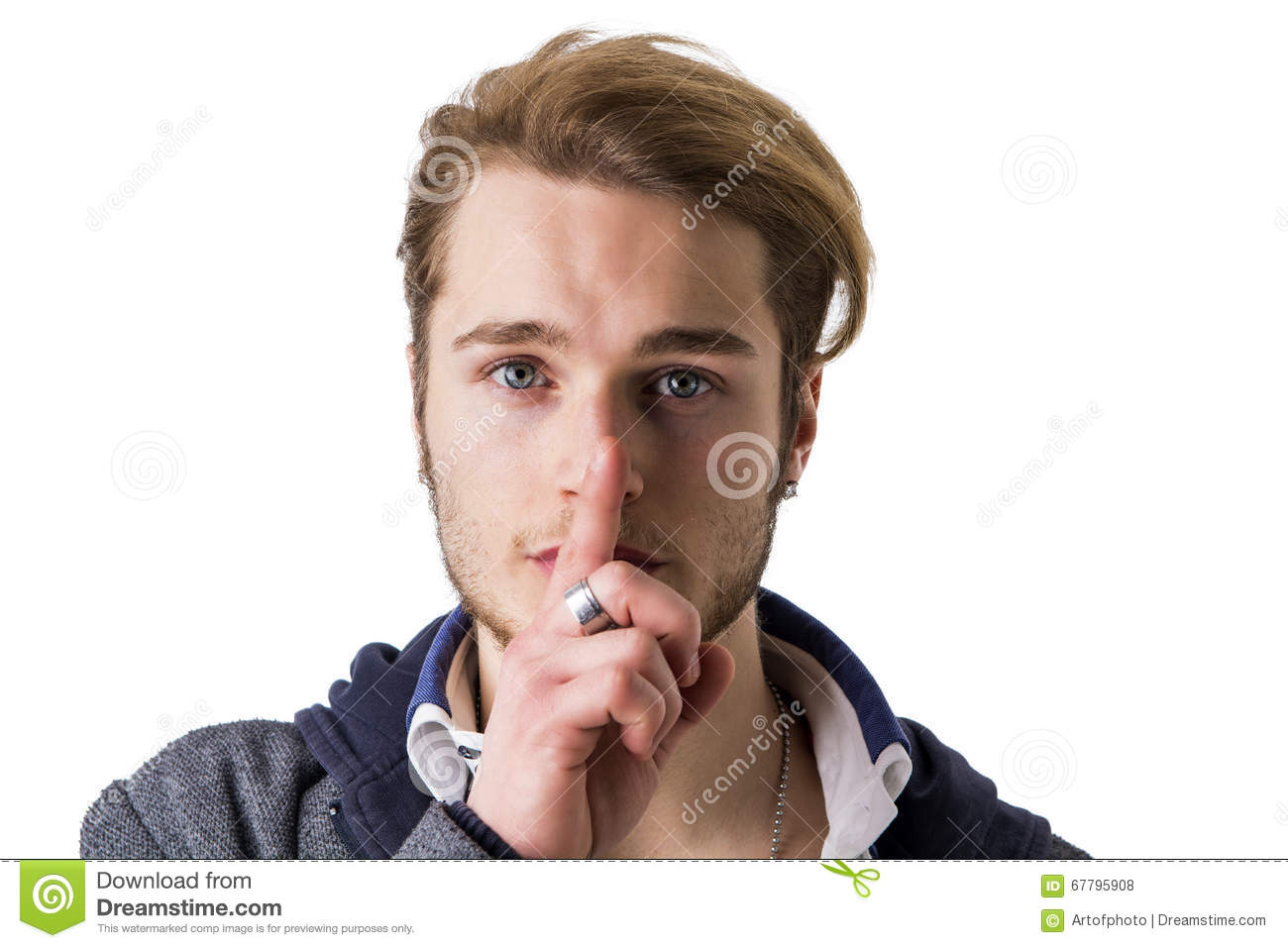 Young Man Gesturing Hush With Finger On Lips Royalty Free