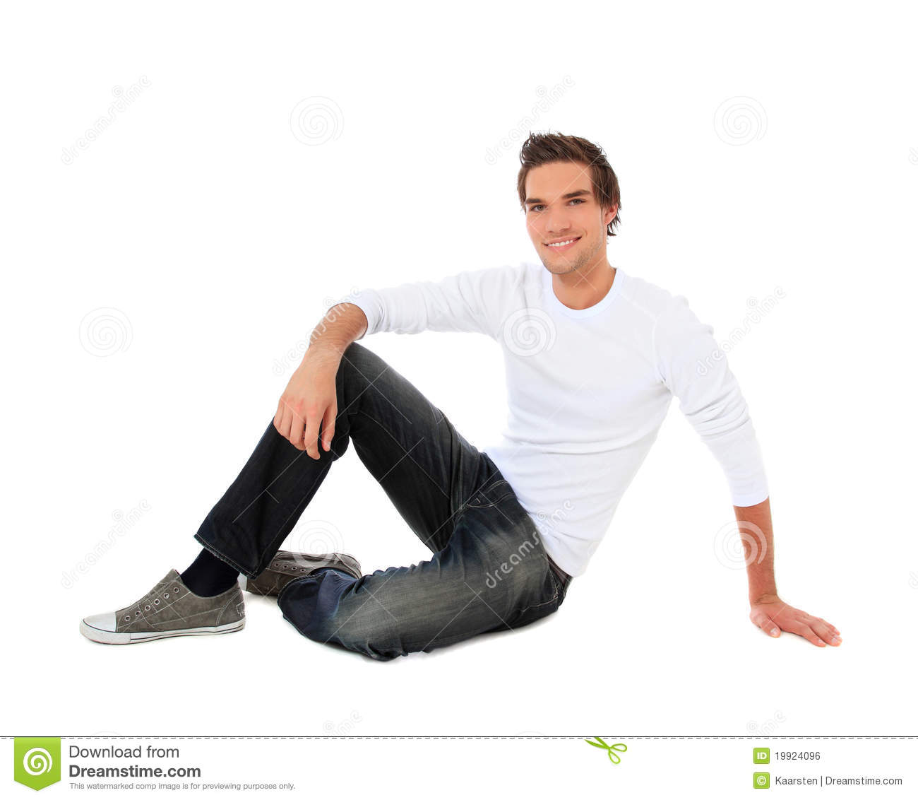attractive young man sitting on the floor royalty free stock image image 19924096. Black Bedroom Furniture Sets. Home Design Ideas