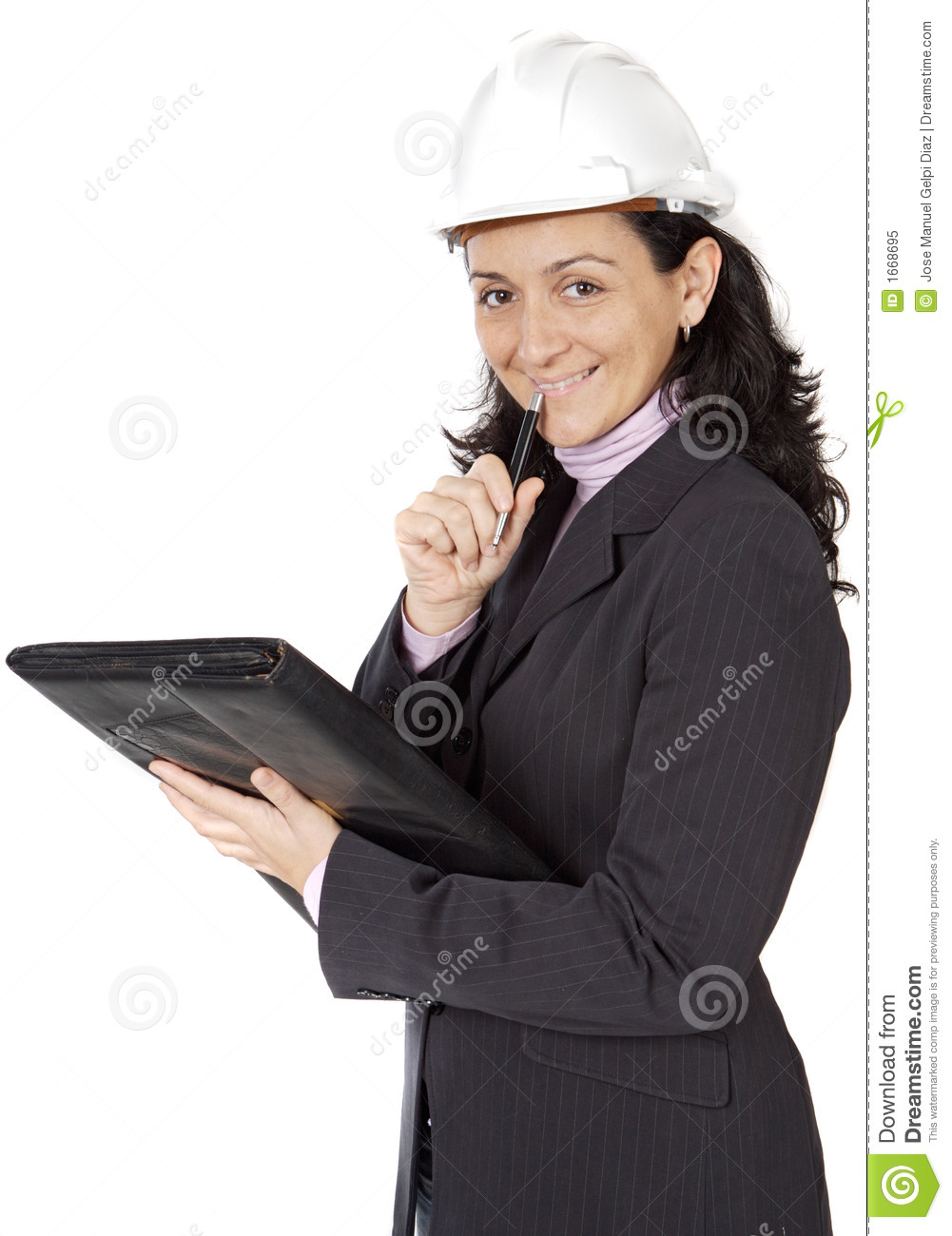 attractive young person architect taking notes in a folder stock
