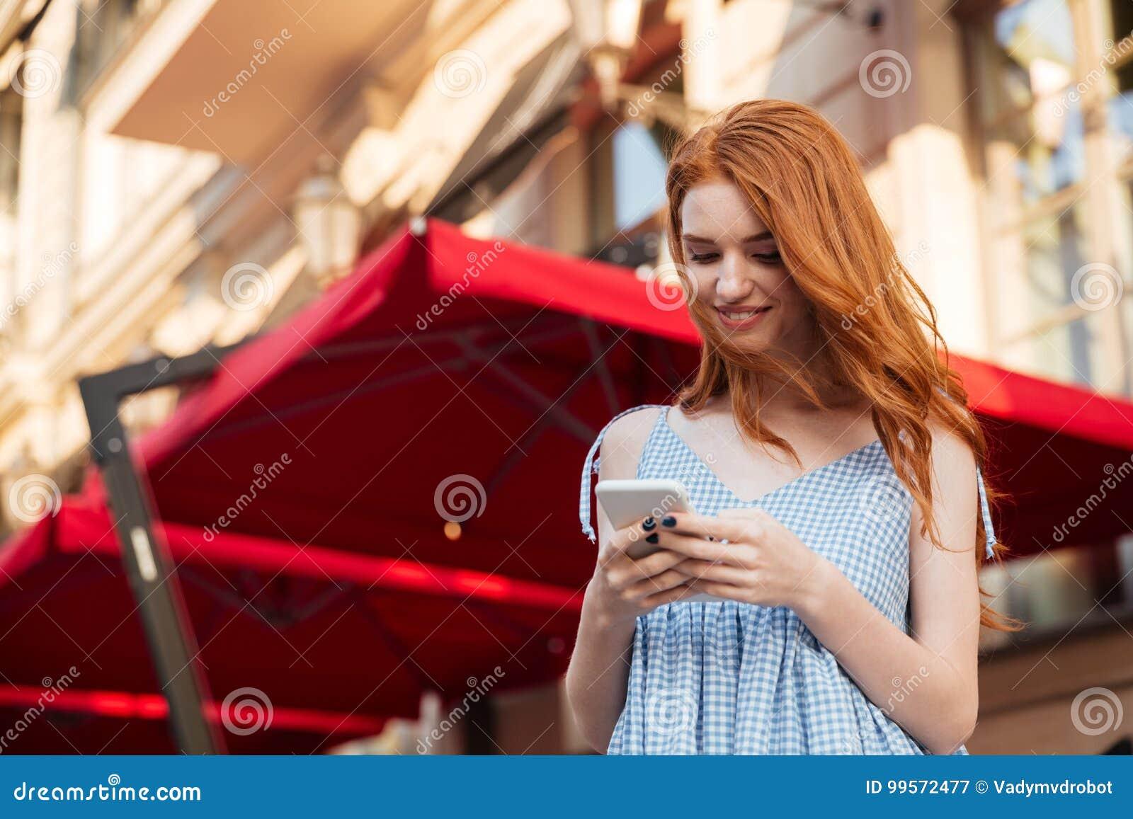 mobile Redhead girl