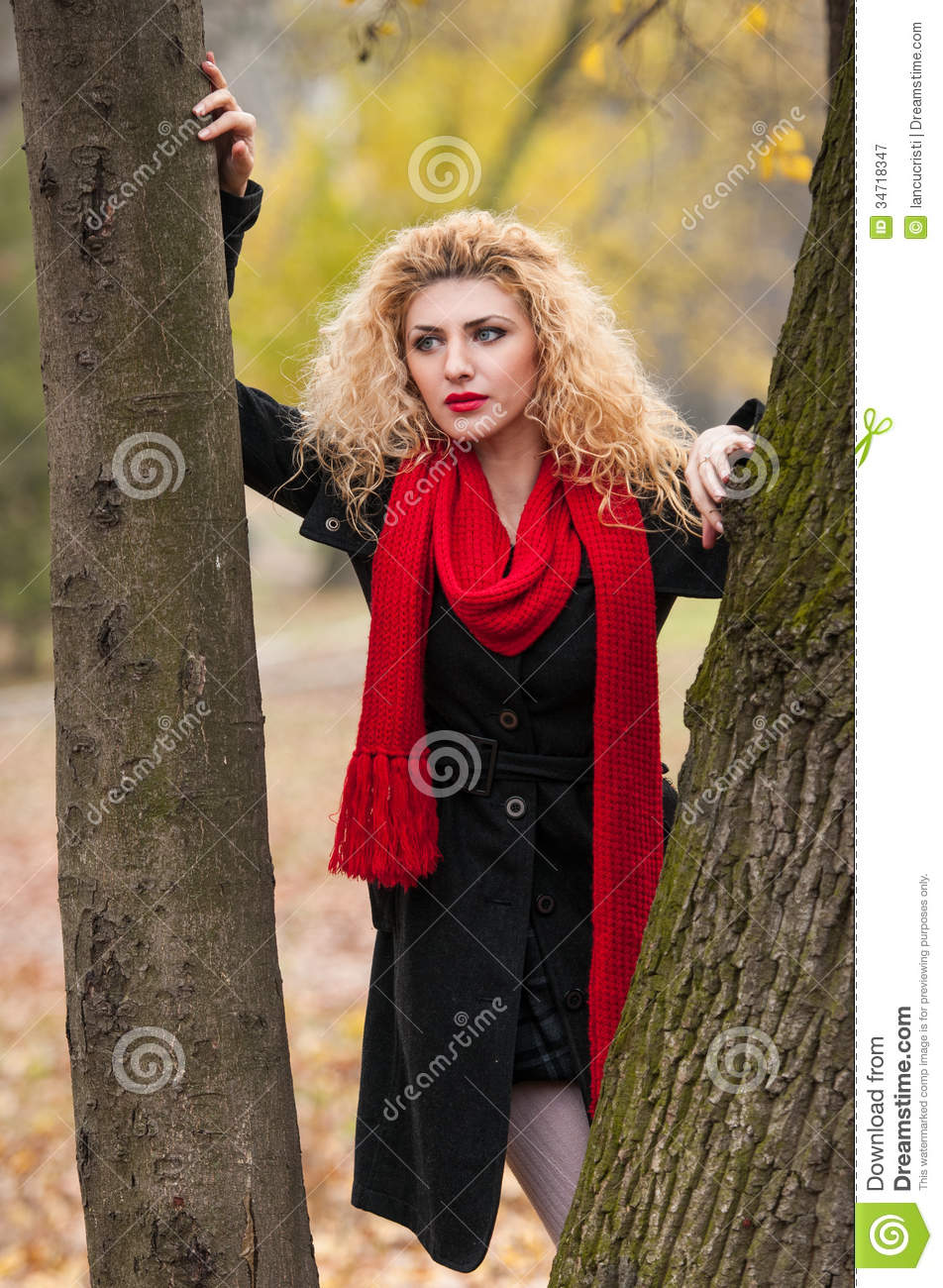 Young Fashion Girl In Autumn Park Stock Photography