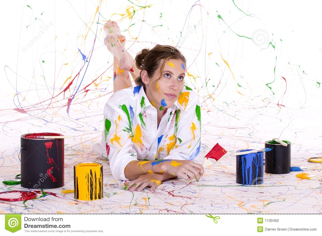 An attractive young woman covered in colorful paint