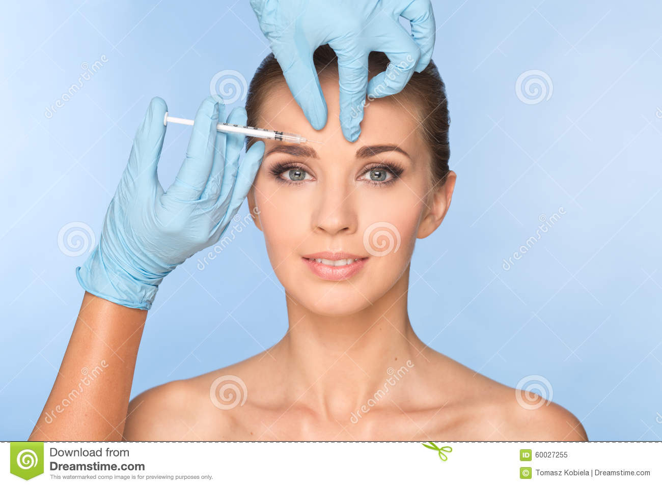 Attractive young woman gets cosmetic injection of botox.