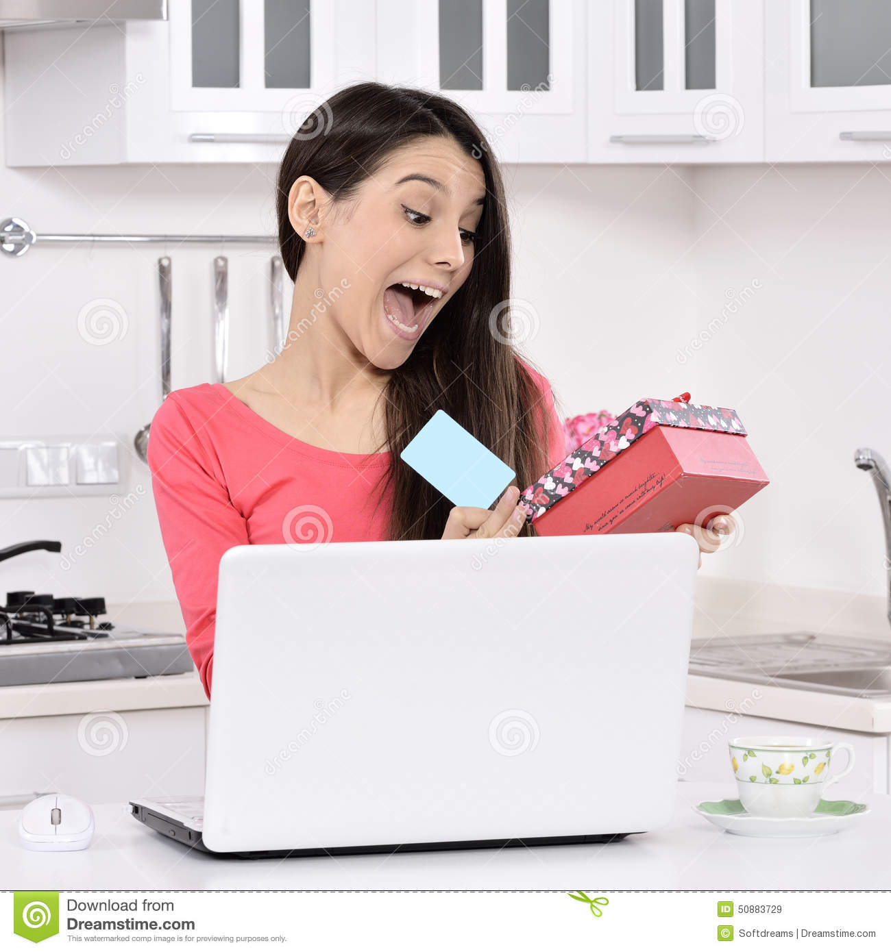 Attractive young woman with gift boxes