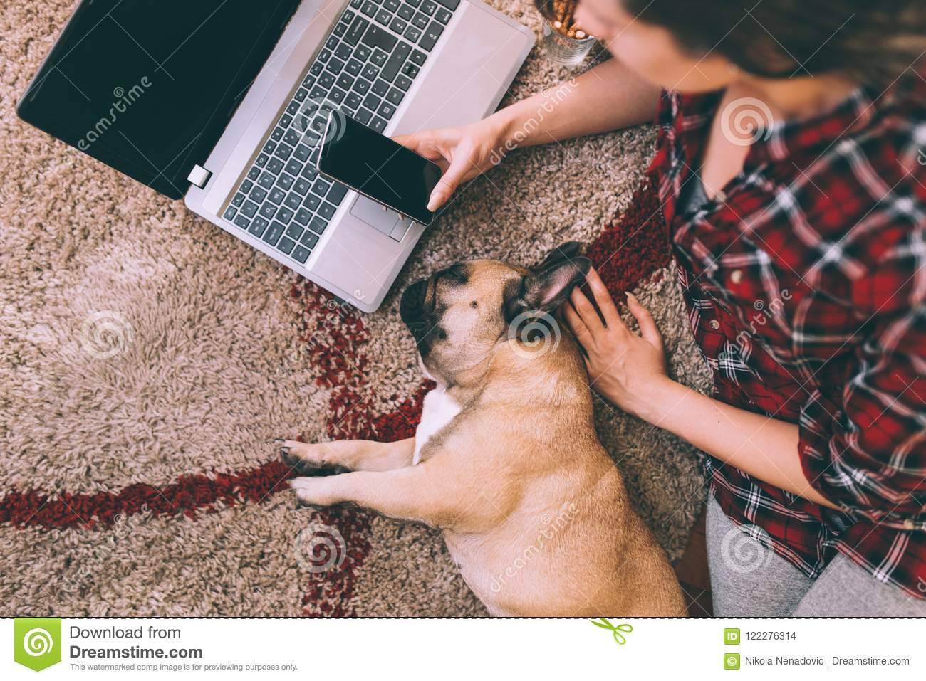 Attractive young woman with her dog