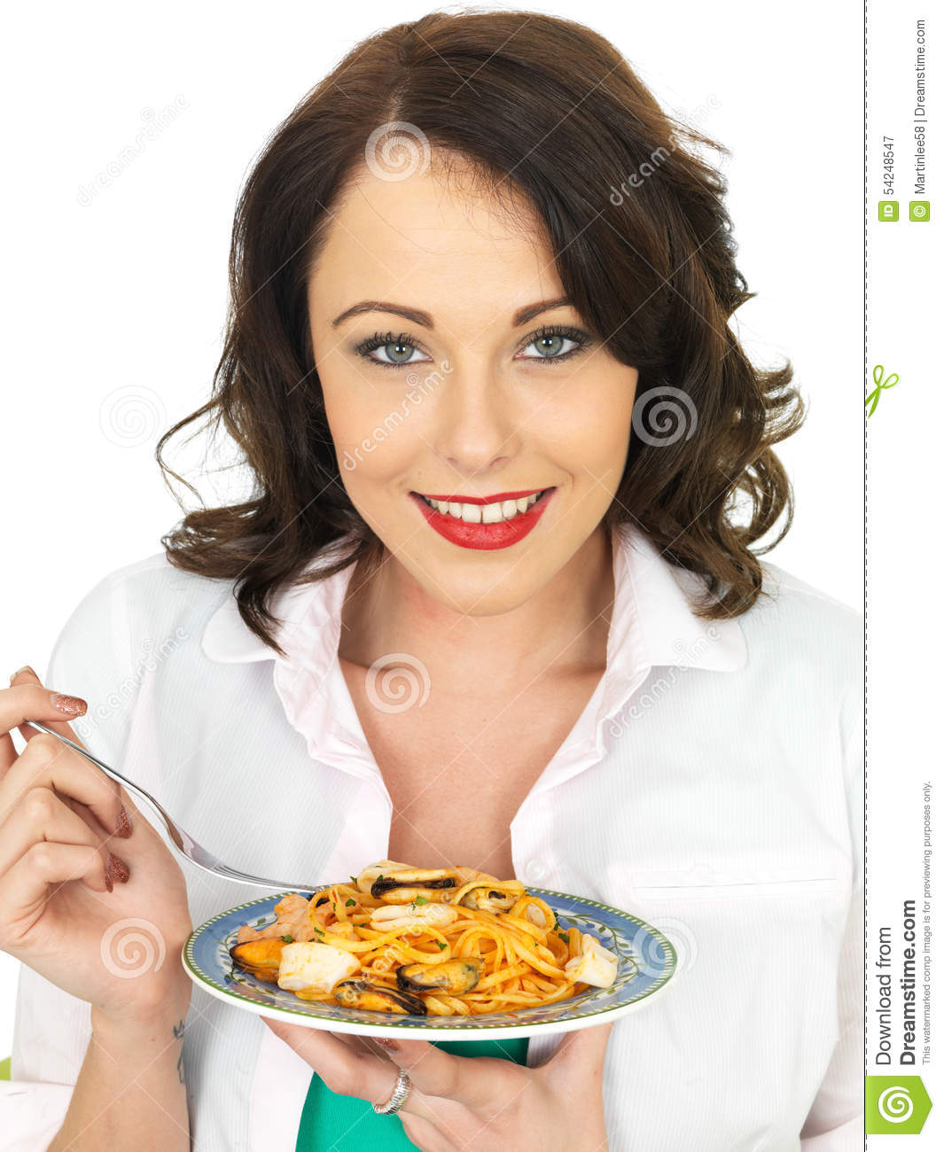 Attractive Young Woman Holding a Plate of Seafood