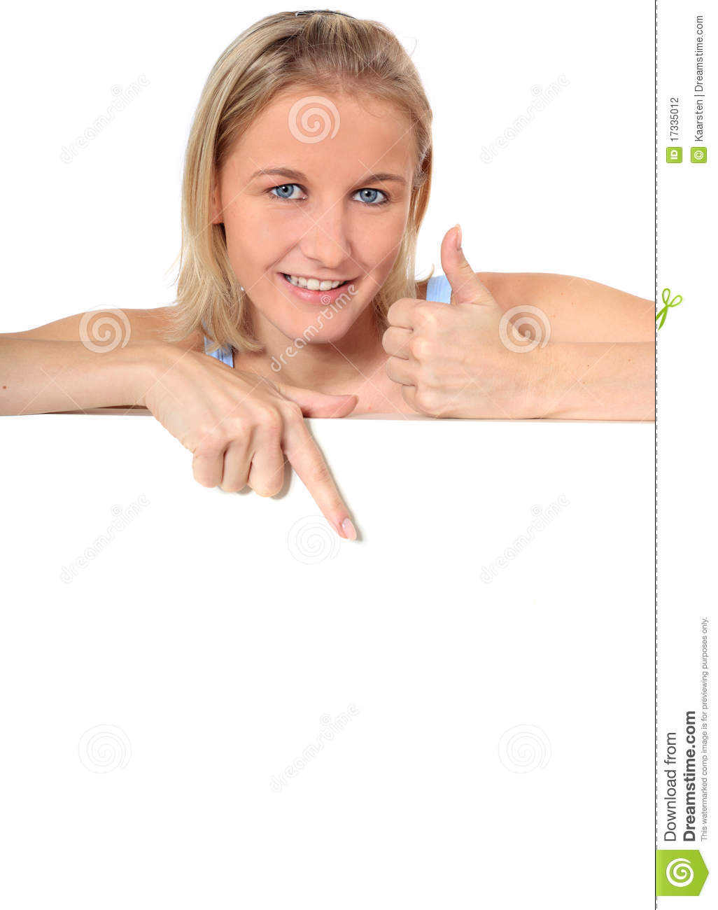 Attractive young woman points down blank sign