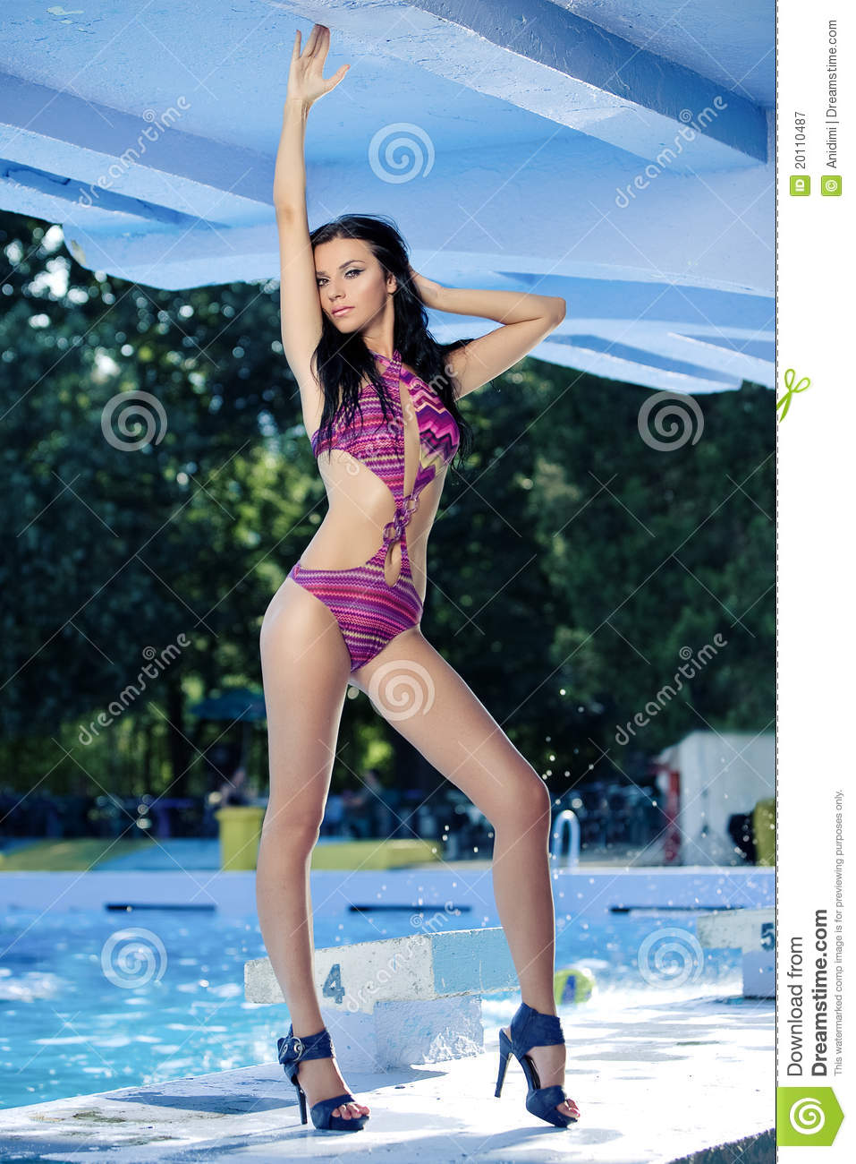 Attractive young woman at a pool