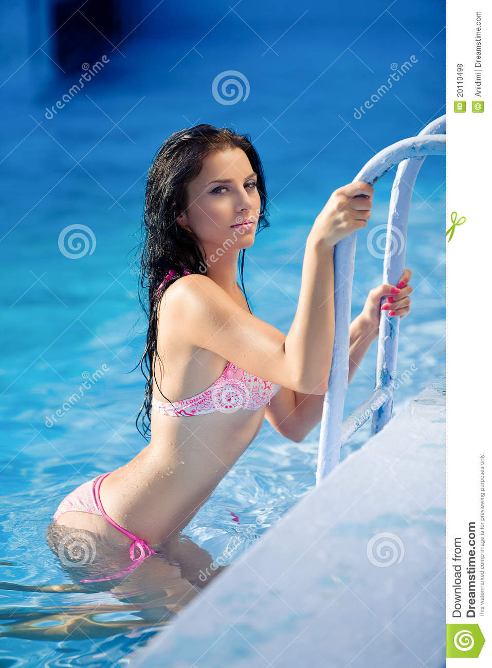 Attractive young woman in pool