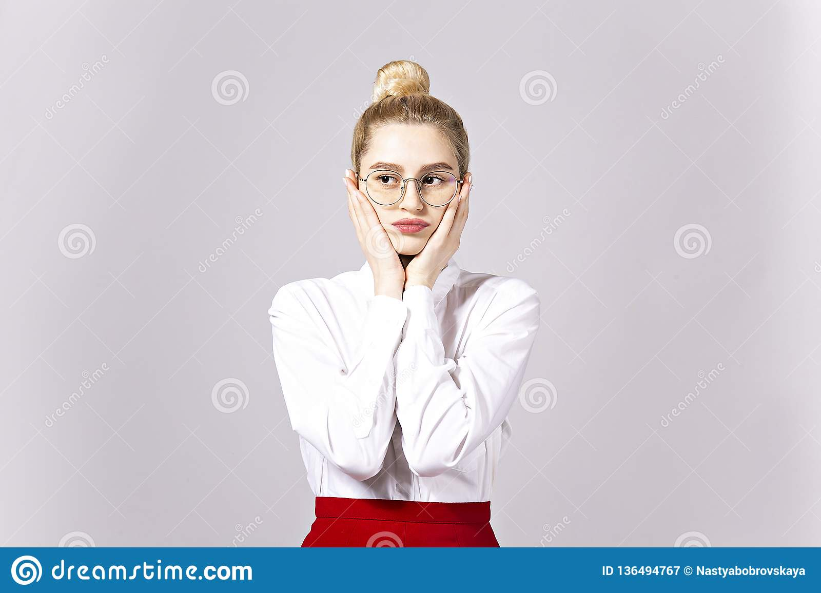 5422c5bed ... blonde business woman wearing round eyeglasses, white cotton blouse top  & tight red skirt. Gray isolated background, copy space, close up, portrait