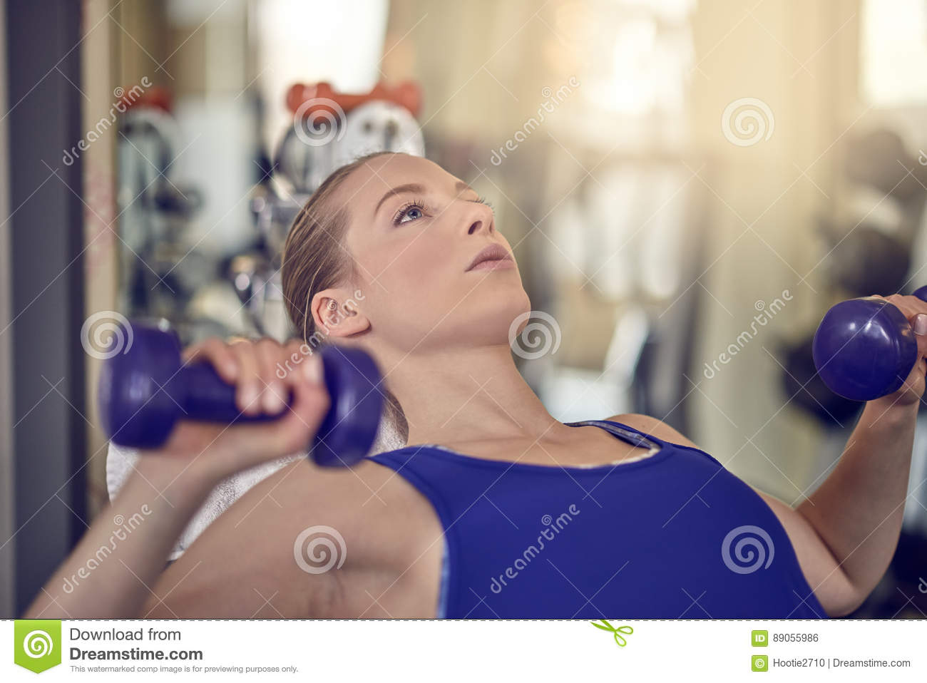 Attractive young woman working out in a gym