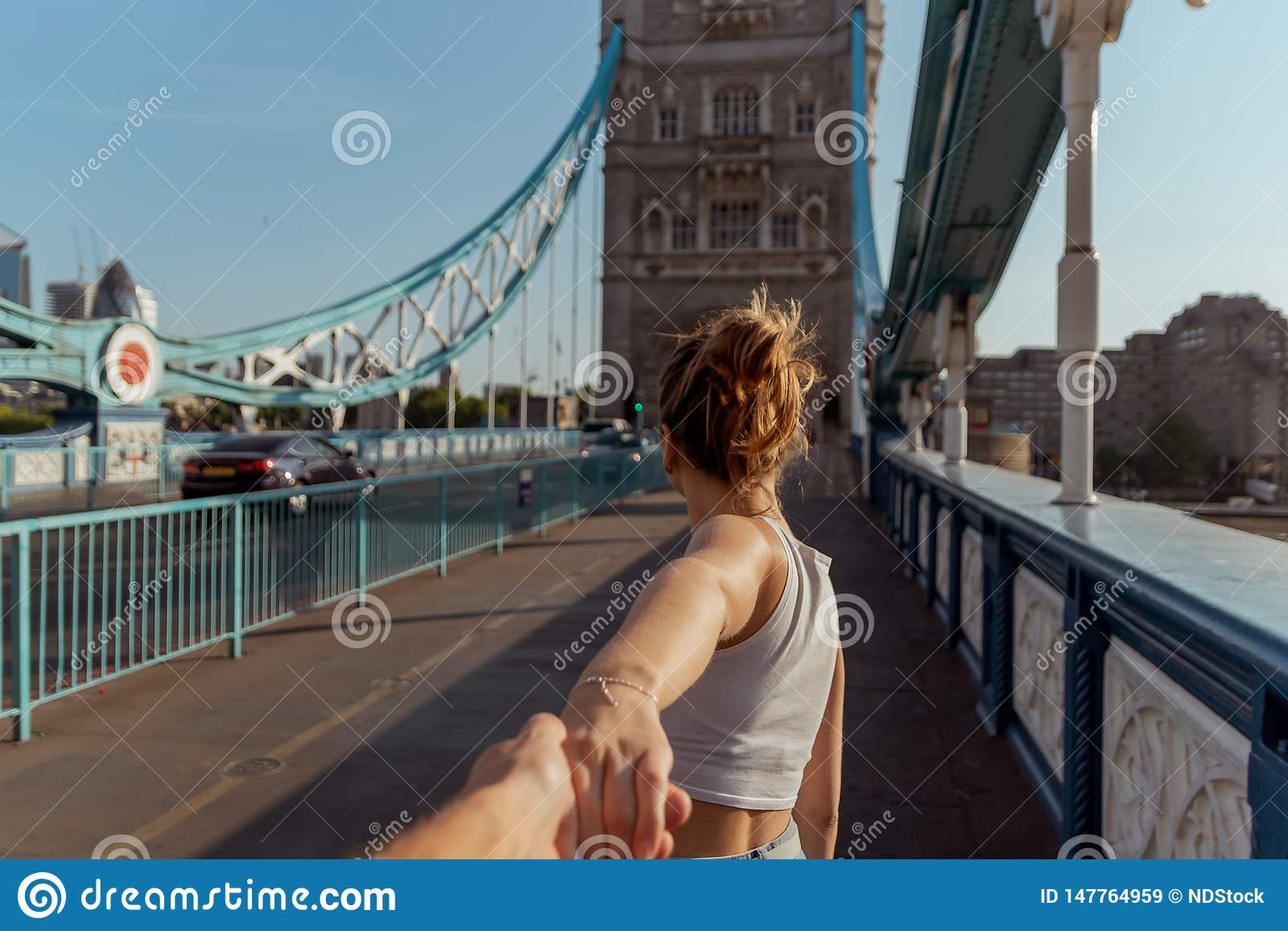 Couple follow me concept on the tower bridge in london