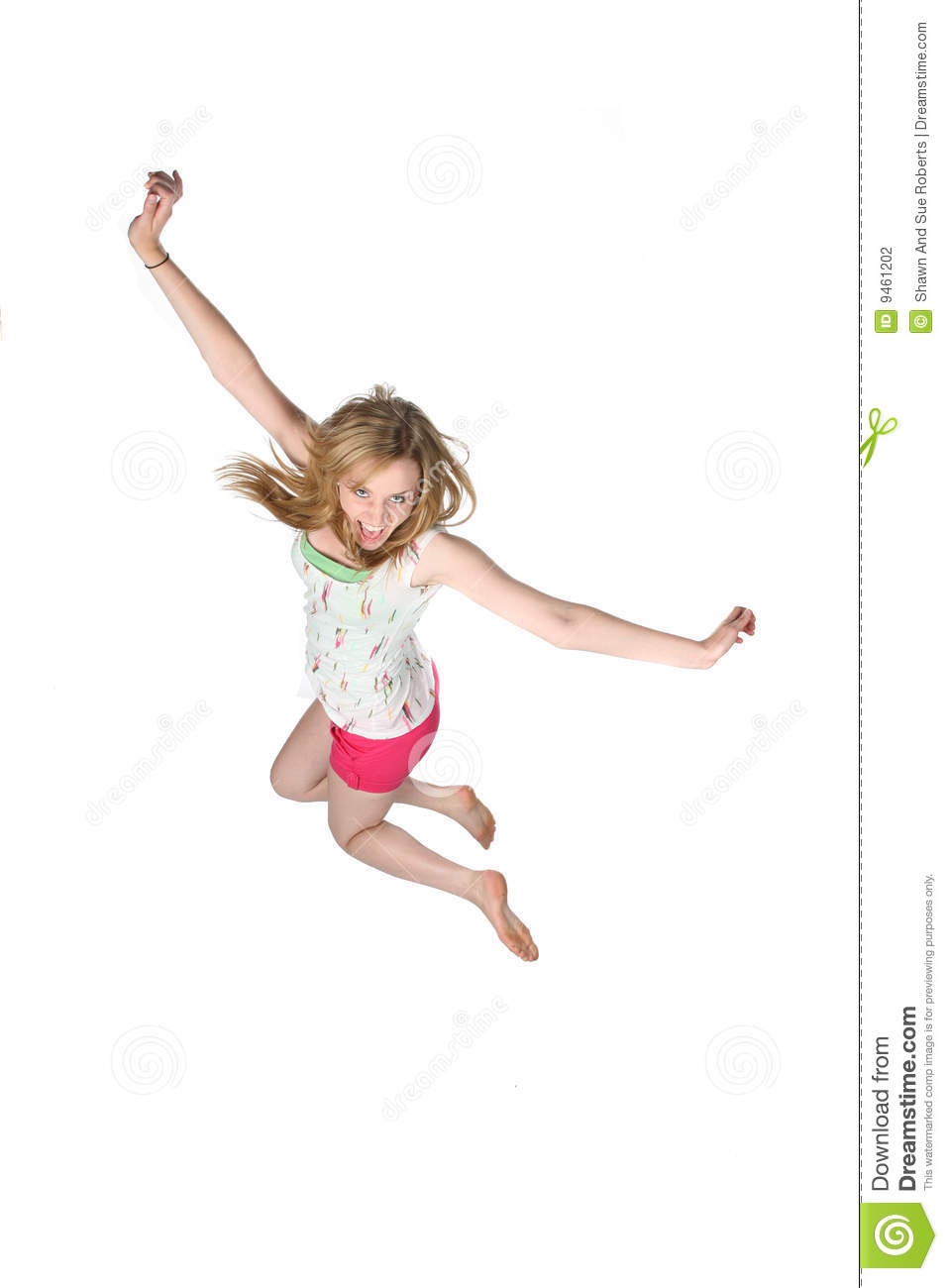Attractivey oung woman jumping for joy