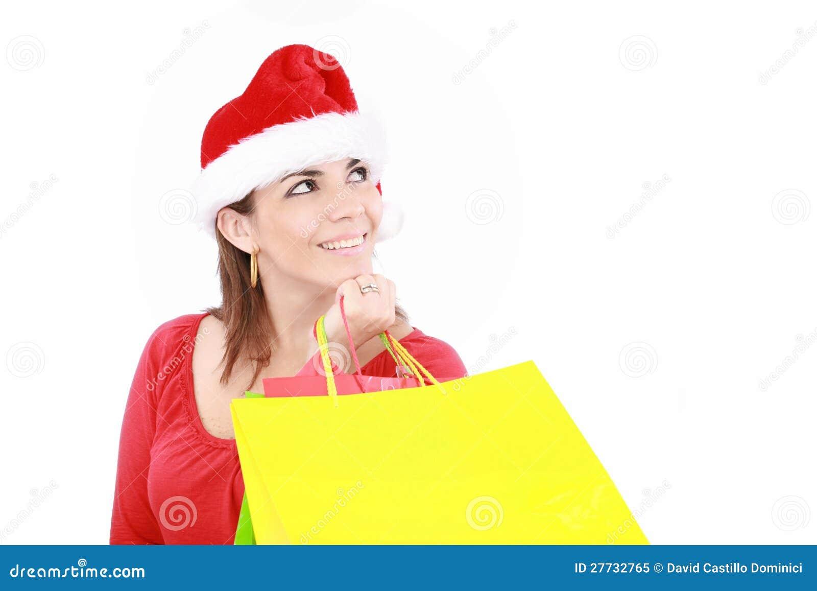 Attraktive Frau in der Weihnachtsschutzkappe