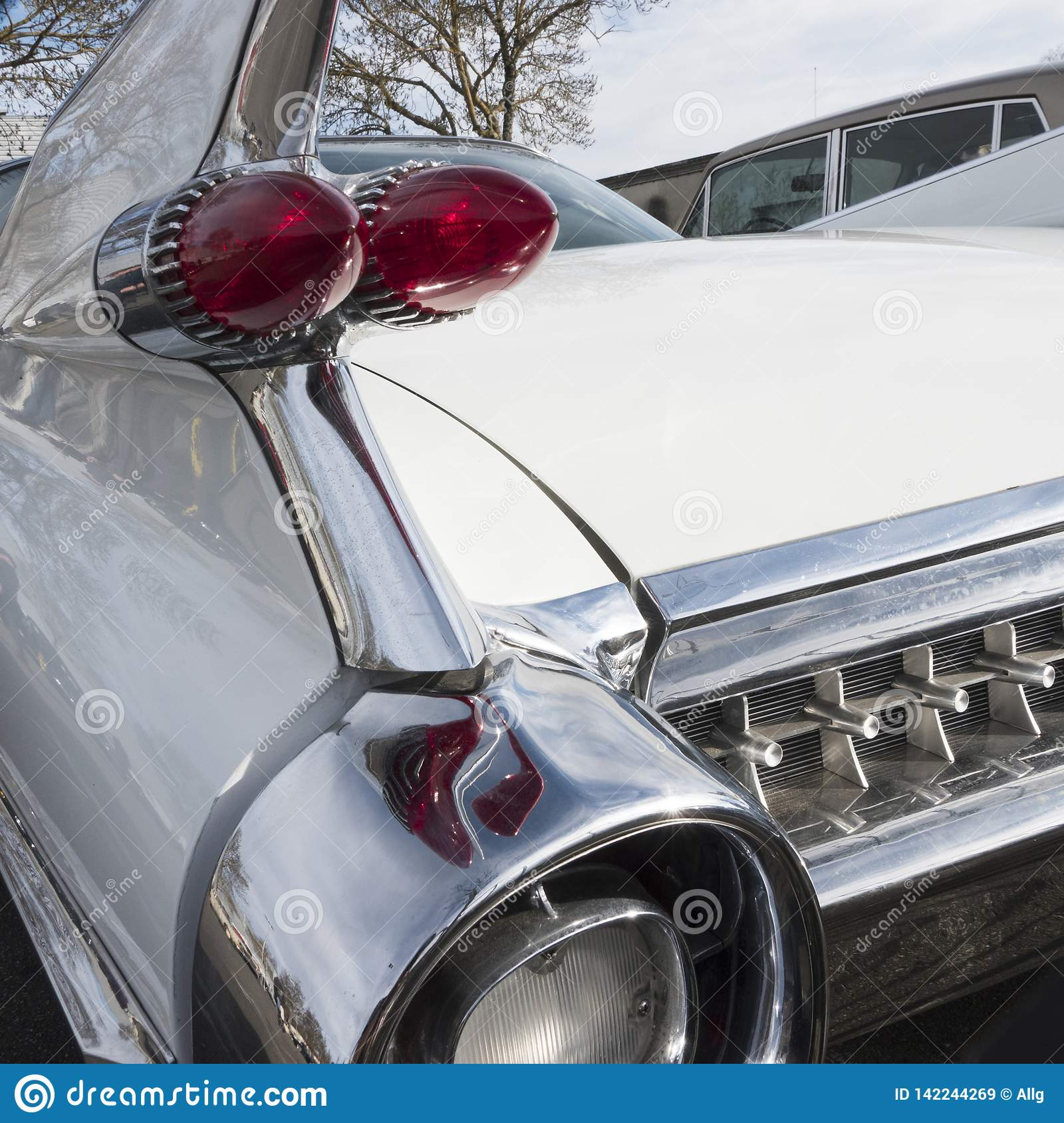 Close-up of the rear of an ancient luxury car.