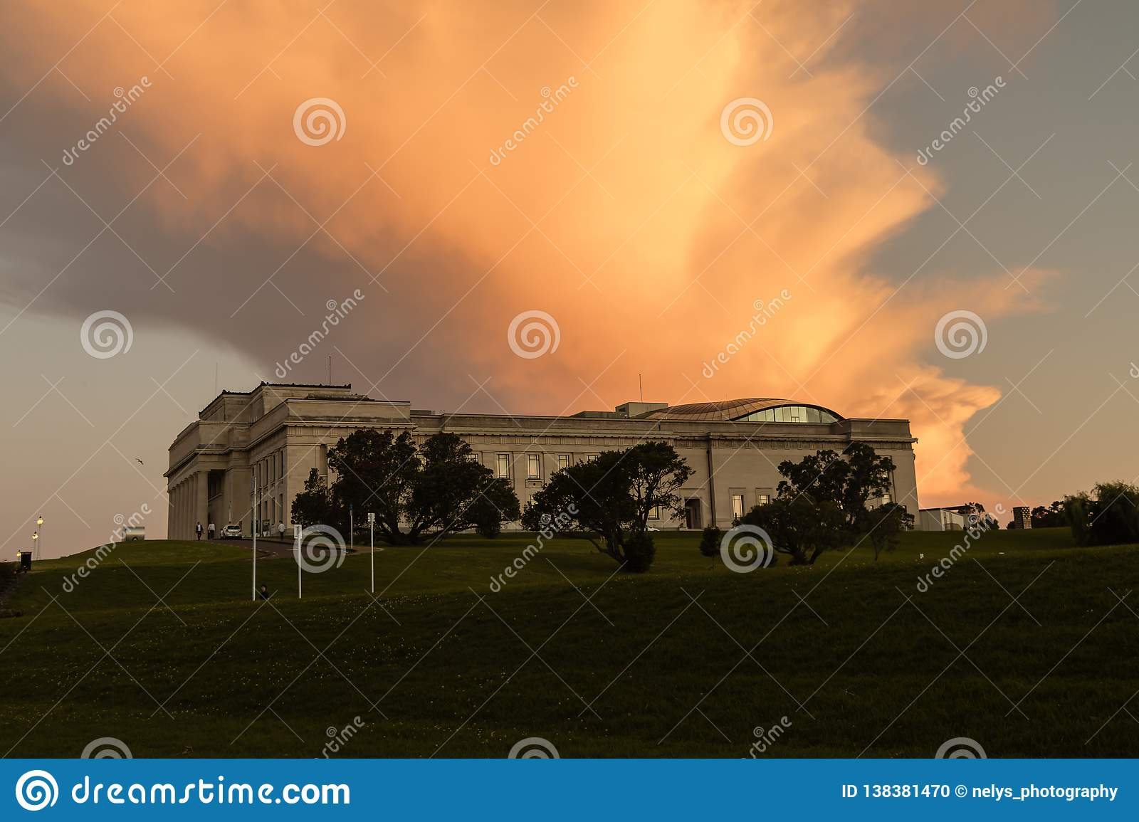 Auckland War Memorial Museum at sunset with orange sky, New Zealand.