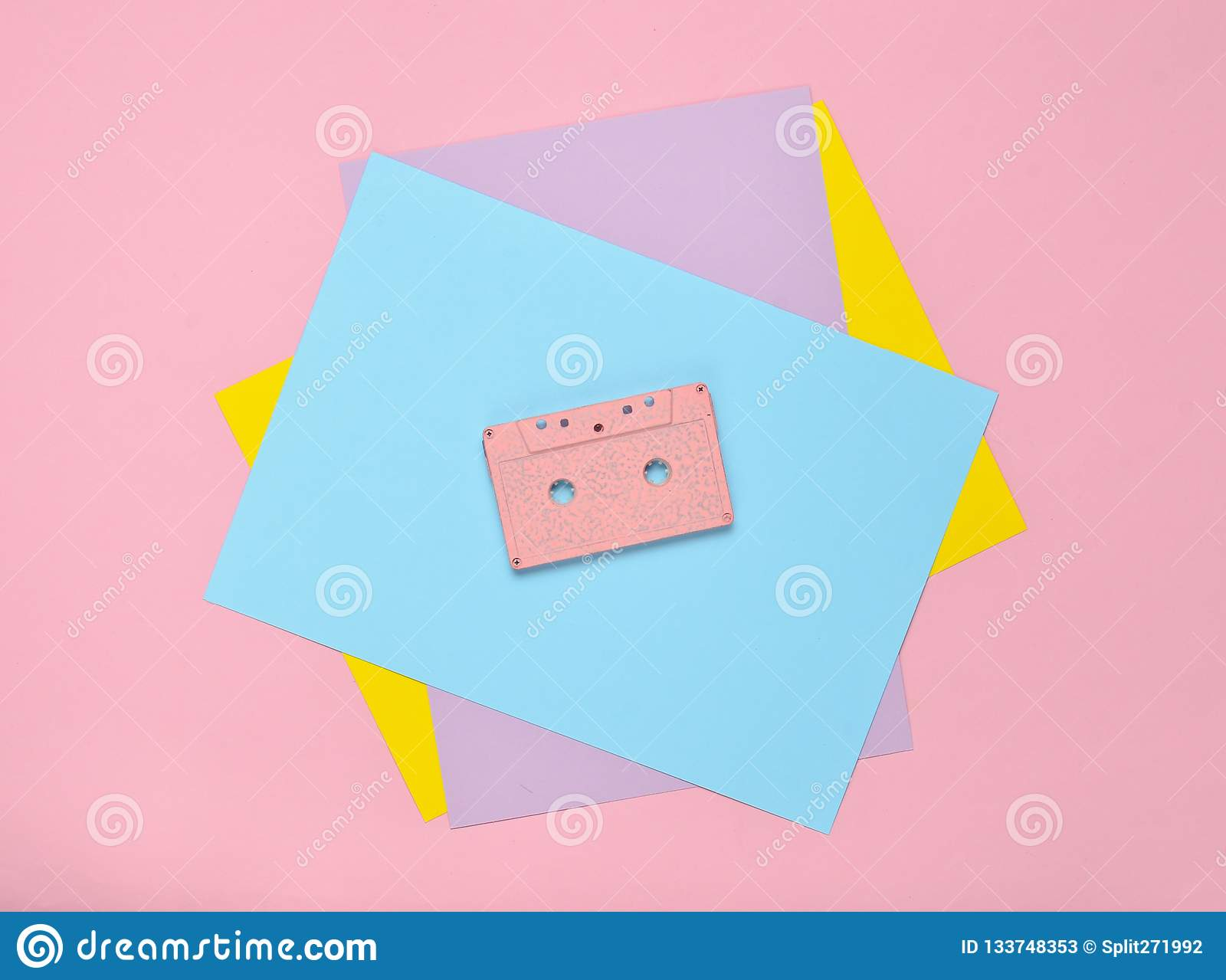 Audio Cassette On A Pastel-colored Paper Background  Retro