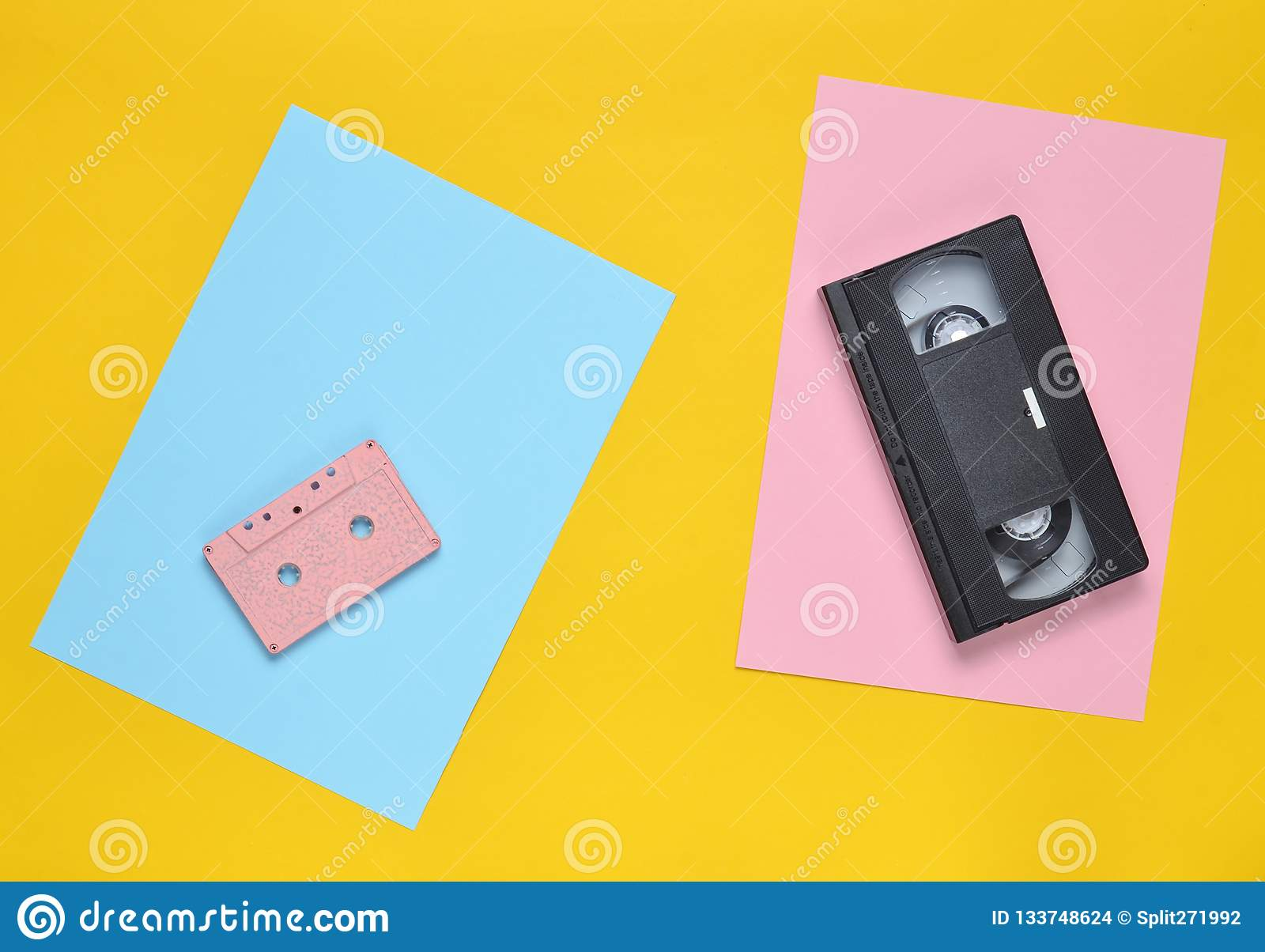 Audio Cassette And Video Cassette On A Colored Paper