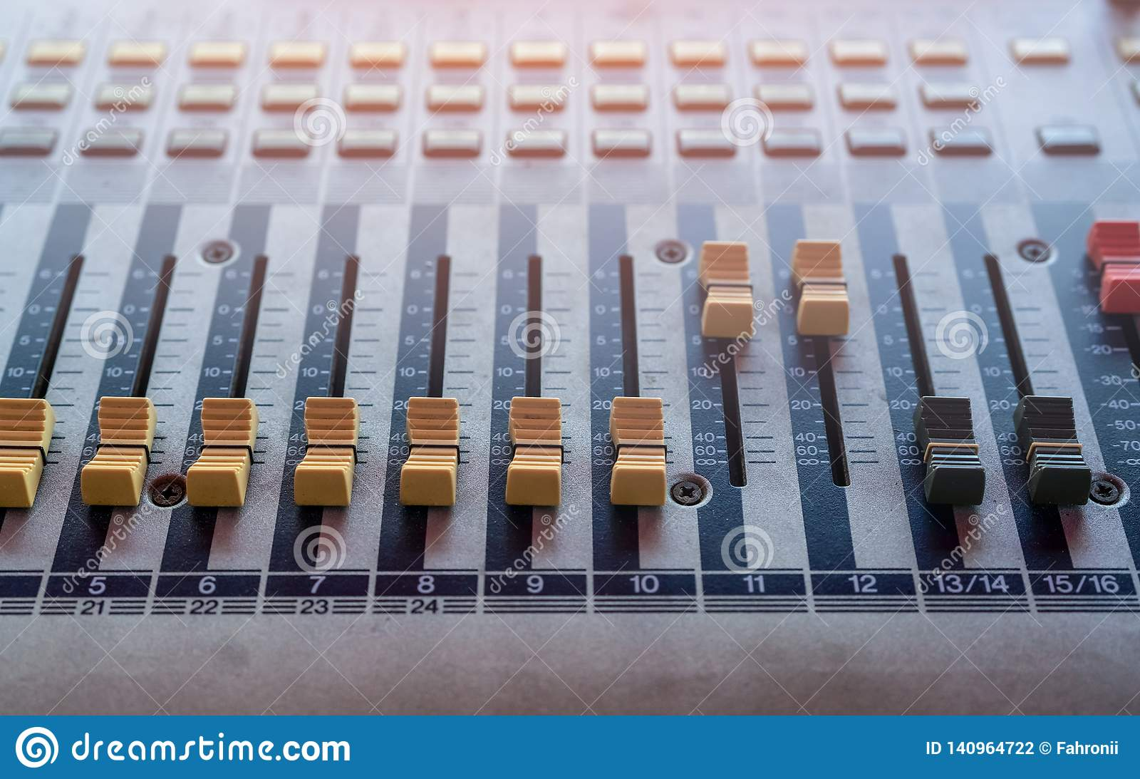 Audio sound mixer console. Sound mixing desk. Music mixer control panel in recording studio. Audio mixing console with faders