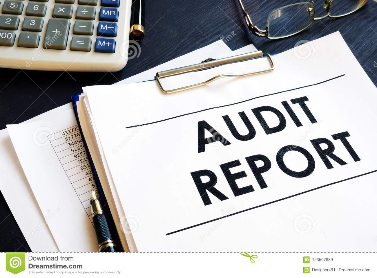 Audit report with business documents in an office.
