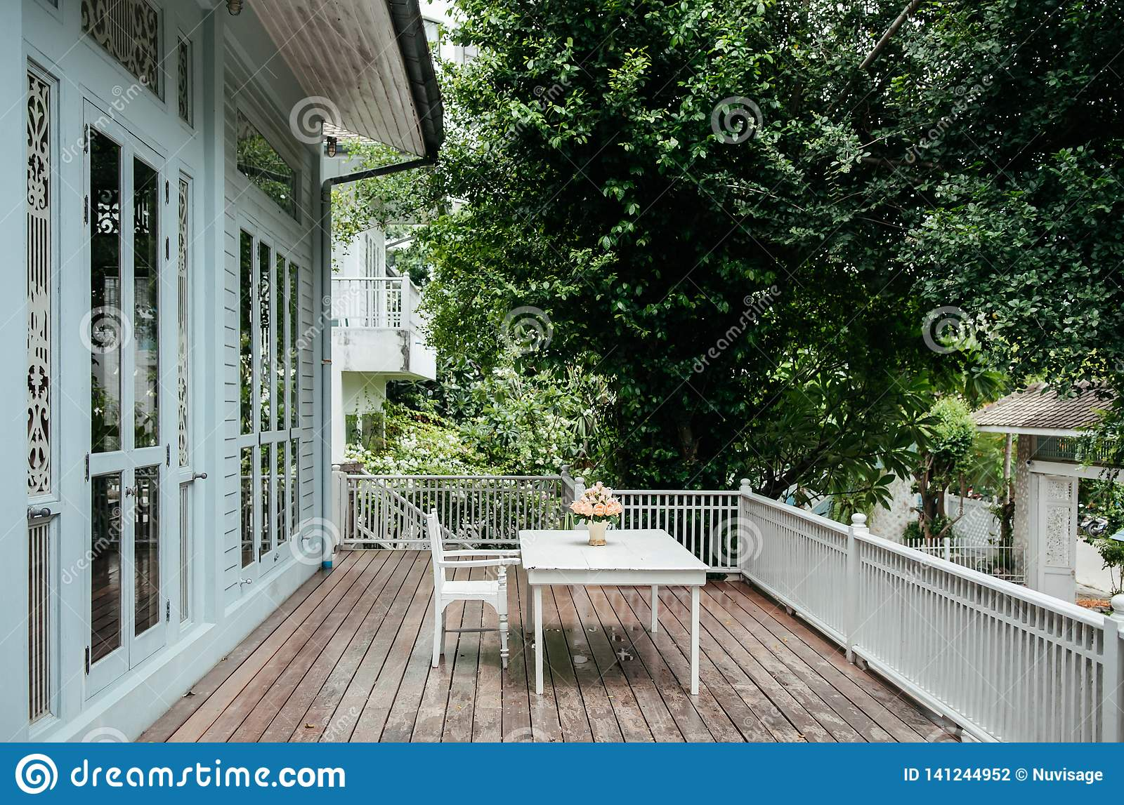 Oriental Vintage Home With Outdoor Wooden Furniture In Old