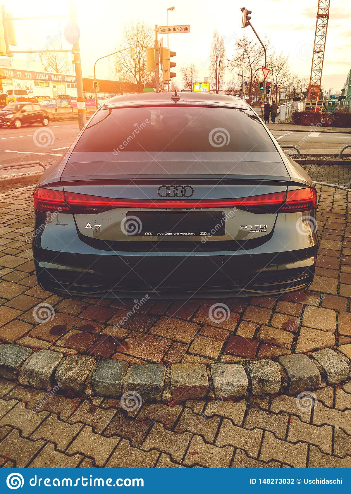 Augsburg, Germany - December 27, 2018: Rear view of black Audi A7 50 TDI Quattro during sunset