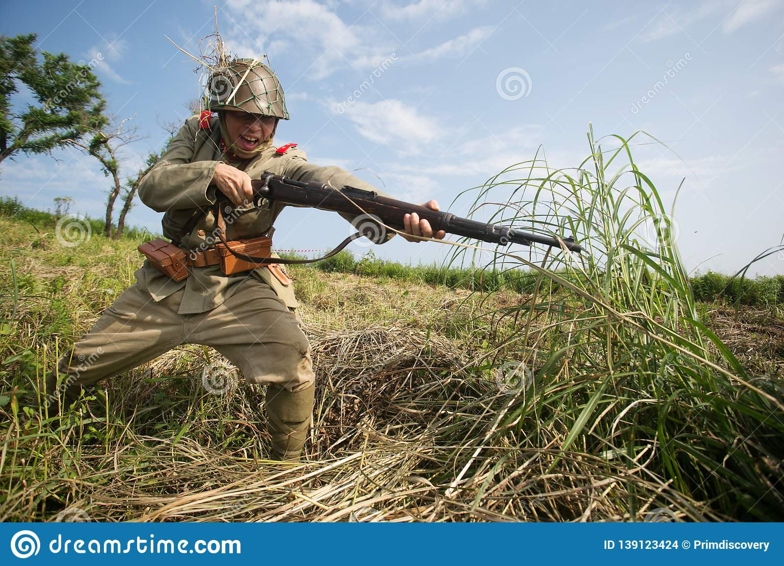 Japanese Soldiers-reenactors Reproduce The Attack On The