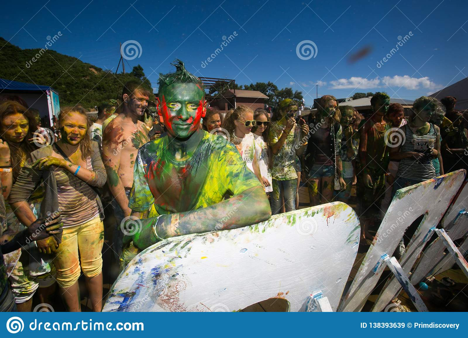 Young, decorated people participate in the Holi festival of colors in Vladivostok.