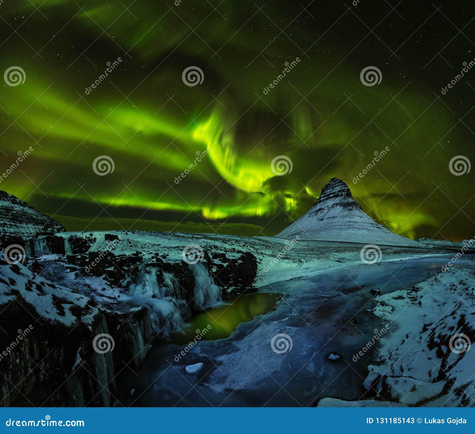 Aurora borealis with Kirkjufell mountain in winter, Iceland