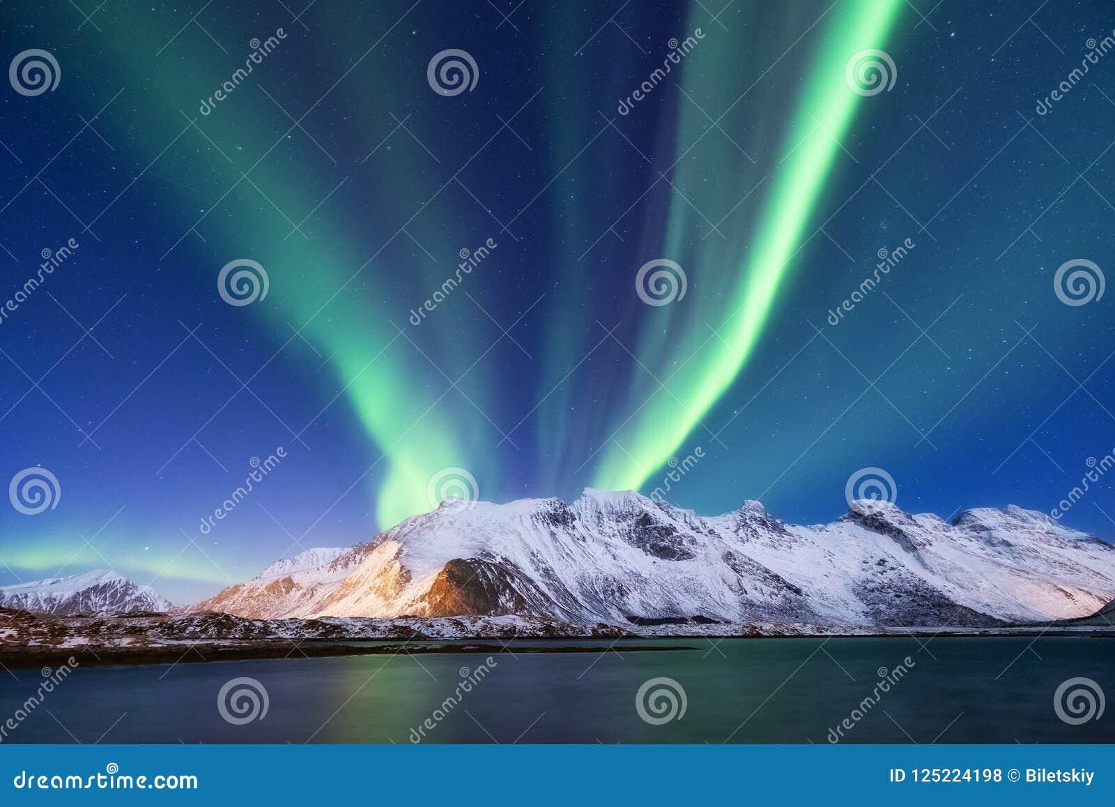 Aurora borealis on the Lofoten islands, Norway. Green northern lights above mountains.