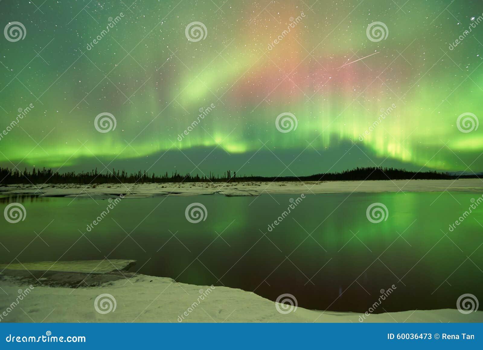 Aurora Borealis over lake