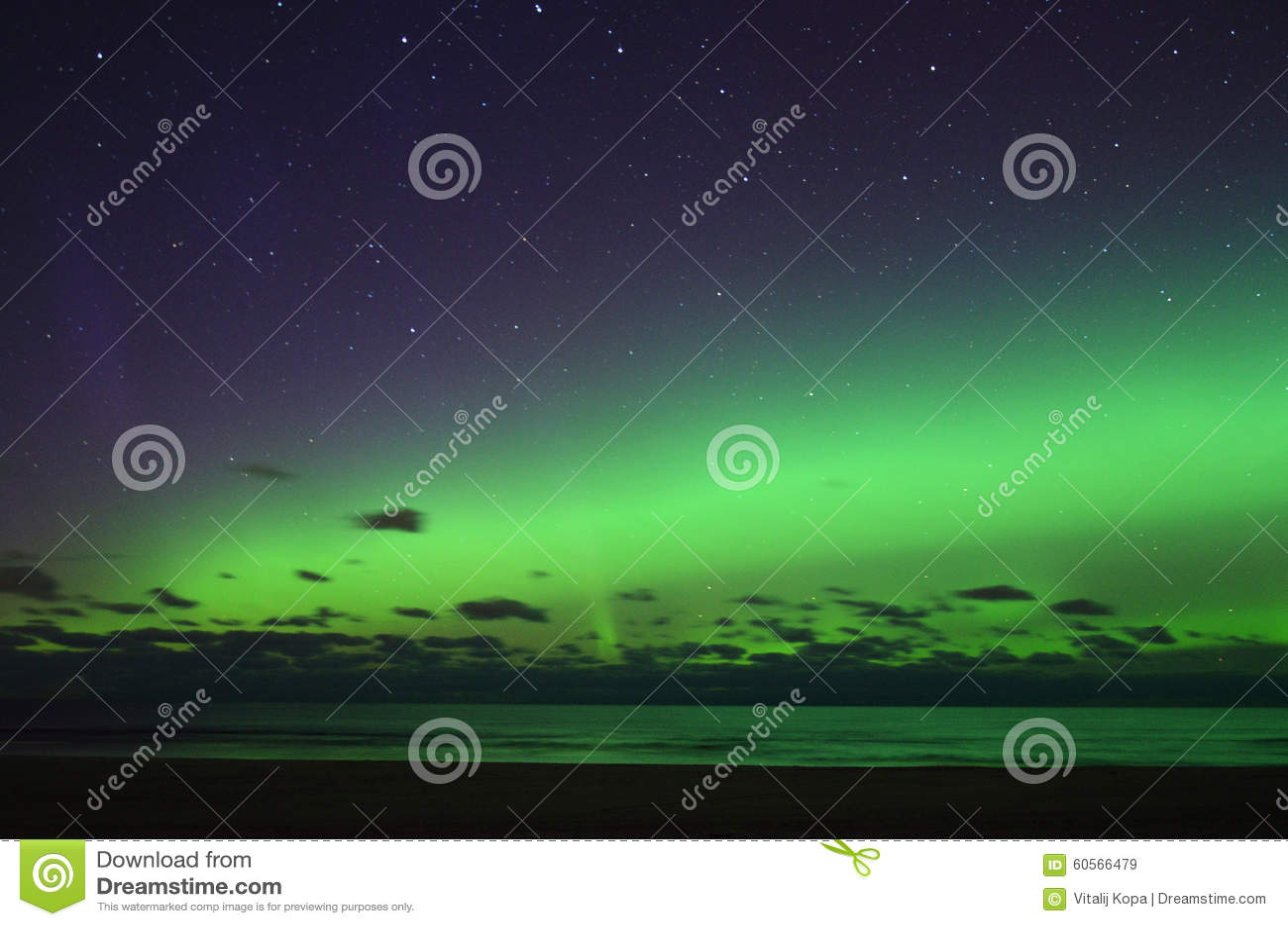 Aurora polar lights and night sky stars over sea