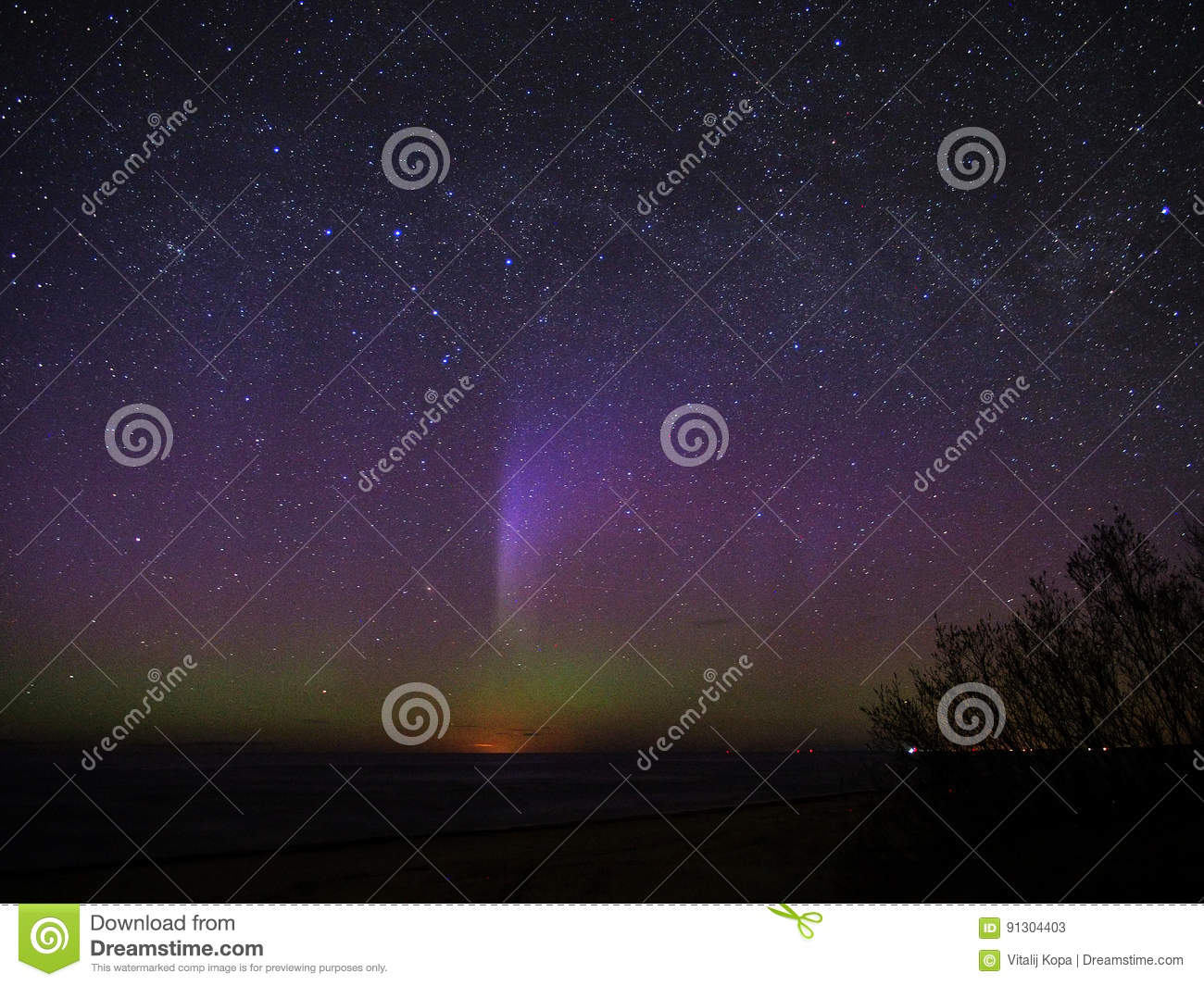 Night sky stars and aurora polar lights over sea