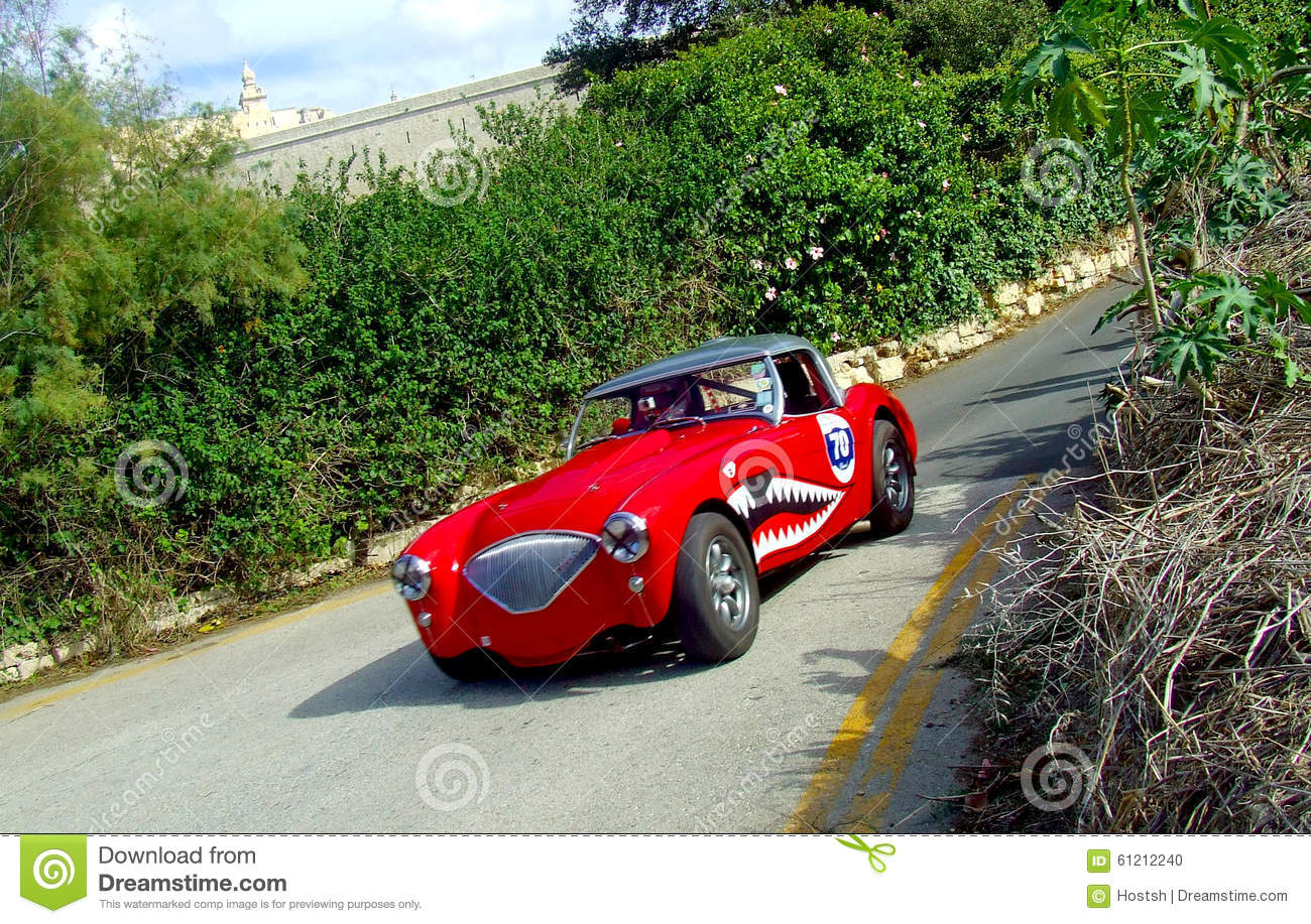 vintage car 1954 austin healey 100 bn1 in race action. Black Bedroom Furniture Sets. Home Design Ideas