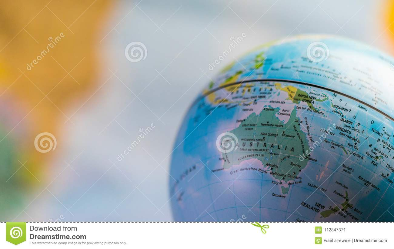 Australia Map Globe.Australia Map On A Globe With Earth Map In The Background Editorial