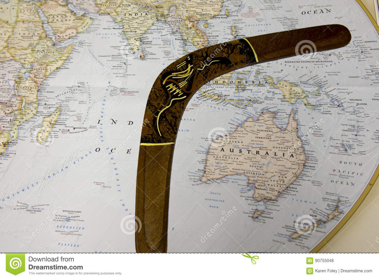 Australia on world map with wooden boomerang